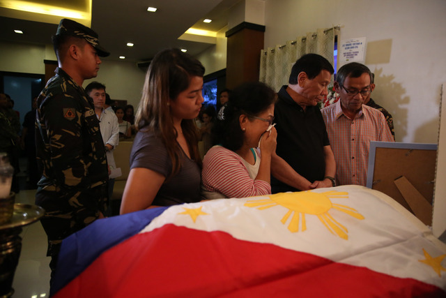 SOFT SPOT. President Rodrigo Duterte condoles with Norman and Nelia Alejo, parents of slain soldier Second Lieutenant Miguel Victor Alejo who was killed in an encounter with communist rebels in Manay, Davao Oriental last February 1,2017. Photo by Toto Lozano/Presidential Photo