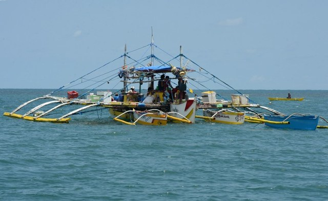 This photo taken on June 16, 2016 shows a fishing vessel anchored at the South China Sea off the town of Infanta in Pangasinan province, as they wait for their fishing expedition to Scarborough Shoal. Ted Aljibe/AFP/File