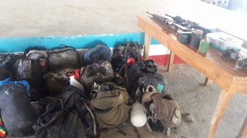 RECOVERED ITEMS. Firearms and personal possessions were among those recovered at the encounter site. Photo from the military