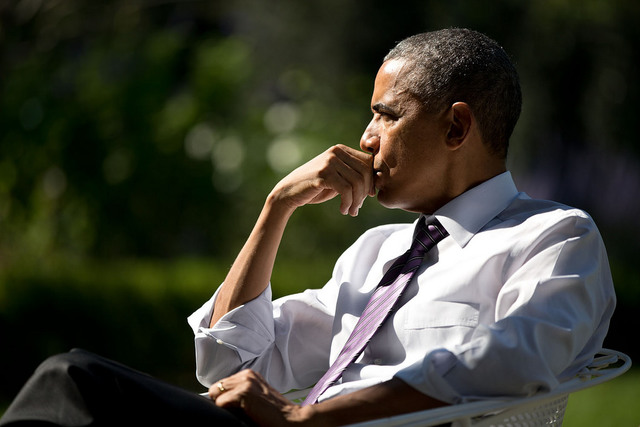 A portrait of US President Barack Obama as he listened during a meeting with staff in the Rose Garden, October 2014. Official White House Photo by Pete Souza