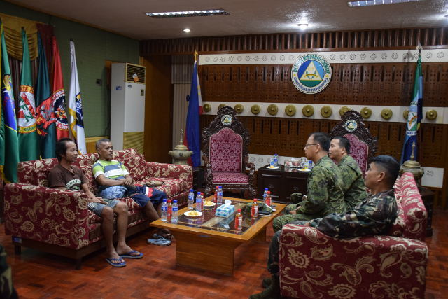 DEBRIEFING. Esteban Janamjam and Dulce Almers are debriefed by the Armed Forces of the Philippines. Photo from Armed Forces of the Philipppines.