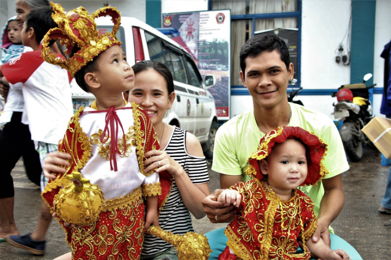 FAMILY TRADITION. The Labatus family takes a pose after the fluvial procession. All photos by Apple Grace Danuco/Rappler